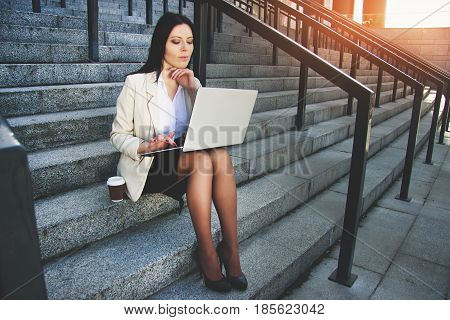 Useful Gadgets For Business. Attractive Young Business Woman In Formal Wear Thinking About Her Work