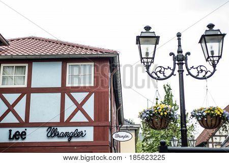 Roermond, Netherlands 07.05.2017 - Logo of the Lee wrangler jeans Store in the Mc Arthur Glen Designer Outlet shopping area