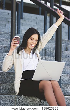 What A Lucky Day. Portrait Of Happy Attractive Young Woman In Smart Casual Wear Keeping Arms Raised