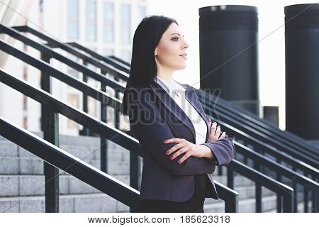 Confident And Successful. Portrait Of Successful Business Woman In Smart Casual Wear Keeping Arms Cr