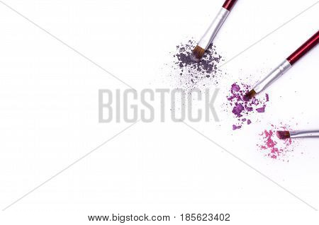 Broken Eye Shadow And Brush Isolated On White Background.