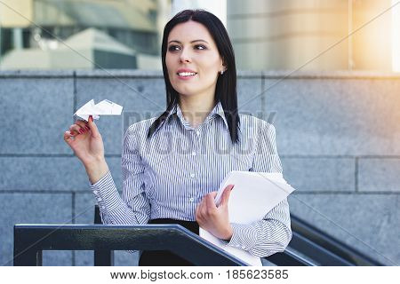 Dreaming About Vacation. Portrait Of Happy Beautiful Business Woman In Smart Casual Wear Keeping Pap