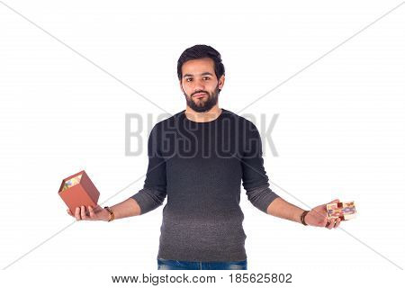 Disappointed beard young man holding opend empty brown gift box guy wearing gray t-shirt and jeans isolated on white background