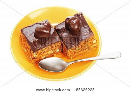 Chocolate cakes on orange plate isolated on a white background
