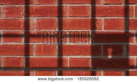 Jail Shadow on Red Bricks Wall Background.