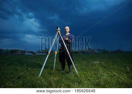Male surveyor for the device in inclement weather