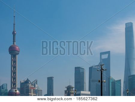 Shanghai, China - Nov 4, 2016: Close view of the Shanghai City skyline shrouded in some afternoon haze. Oriental Pearl TV tower is at left of frame.