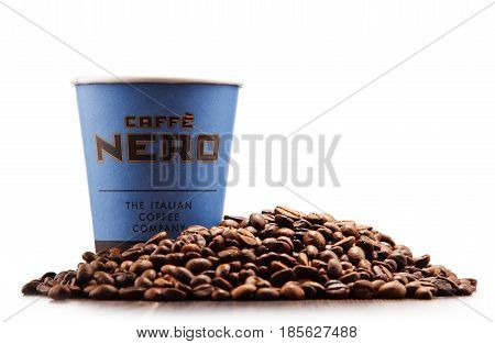 Composition With Cup Of Caffe Nero Coffee And Beans