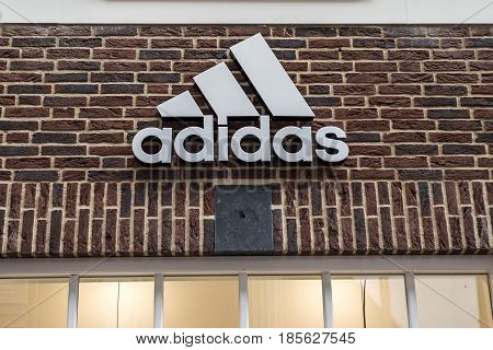 Roermond Netherlands 07.05.2017 - Logo of the adidas brick house Store in the Mc Arthur Glen Designer Outlet shopping area