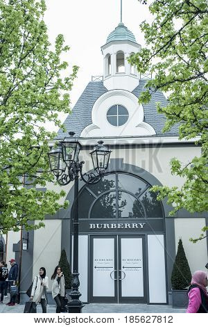 Roermond Netherlands 07.05.2017 - Logo of the Burberry Store in the Mc Arthur Glen Designer Outlet shopping area