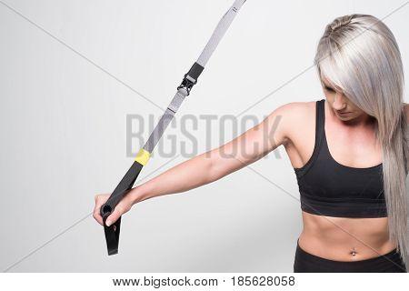 Female Using A Suspension Trainer