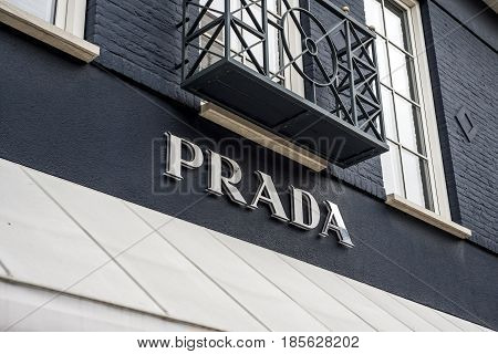 Roermond Netherlands 07.05.2017 - Logo of the Prada luxury Store in the Mc Arthur Glen Designer Outlet shopping area