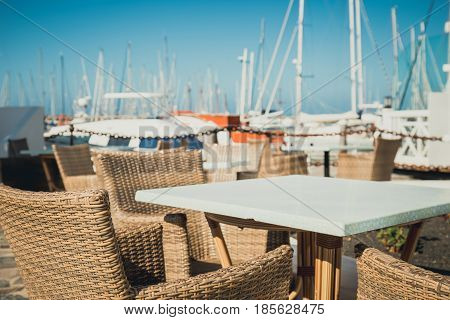 Table and chairs in marina Rubicon in Playa Blanca Lanzarote Canary Island Spain