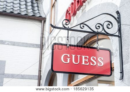 Roermond Netherlands 07.05.2017 - Logo of the GUESS clothes Store in the Mc Arthur Glen Designer Outlet shopping area