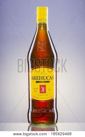 Arehucas rum on gradient background. Arehucas distillery situated on Canary Islands was founded in 1884.