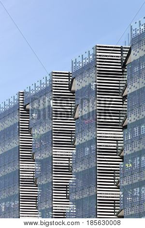 Photovoltaic glass panels on a wall of a building
