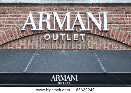 Roermond, Netherlands 07.05.2017 - Logo and shop of Armani Store Mc Arthur Glen Designer Outlet shopping area