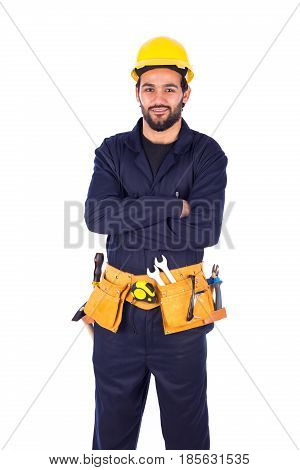 Handsome beard young worker crossing his arms guy wearing workwear and yellow helmet with belt equipment isolated on white background