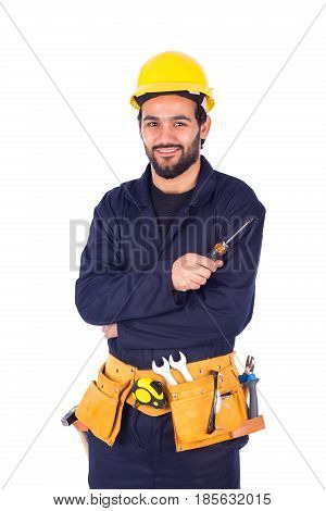 Handsome beard young worker smiling and holding a screwdriver guy wearing workwear and yellow helmet with belt equipment isolated on white background