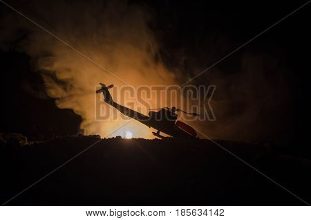 Air Crash. Burning Falling Helicopter. Destroyed Helicopter. Decorated With Toy At Dark Fire Backgro
