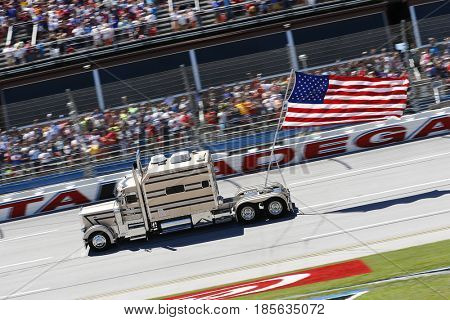 May 07, 2017 - Talladega, Alabama, USA: A truck flies an American flag thru the trial-oval during pre-race ceremonies for the GEICO 500 at Talladega Superspeedway in Talladega, Alabama.
