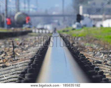 The rail of the railroad goes somewhere far away