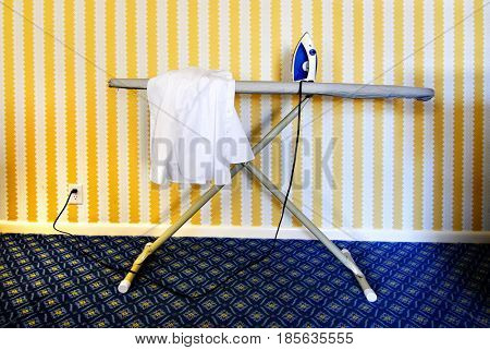Iron and ironing board to launder clothing