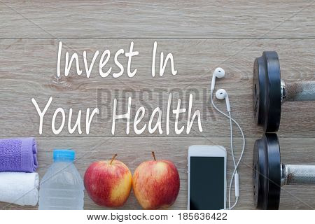 Invest in your health Healthy lifestyle concept with diet and fitness Get fit in this year fitness equipment and healthy food.