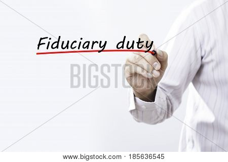 Businessman hand writing Fiduciary duty with red marker on transparent wipe board business concept.
