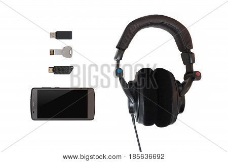 Multiple flash memories with a cellphone and headphones on isolated white