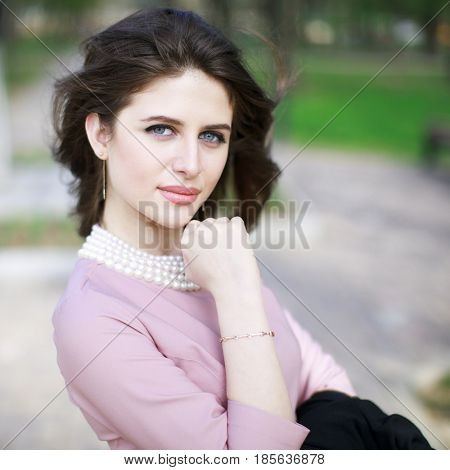 Portrait of a young beautiful Armenian girl in a pink dress