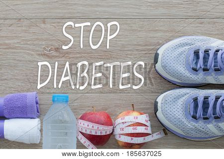 Concept STOP DIABETES and against healthy on wooden