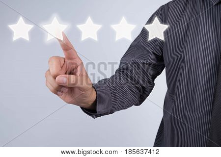 evaluation concept. Businessman pointing five star to increase rating of company Increase rating.