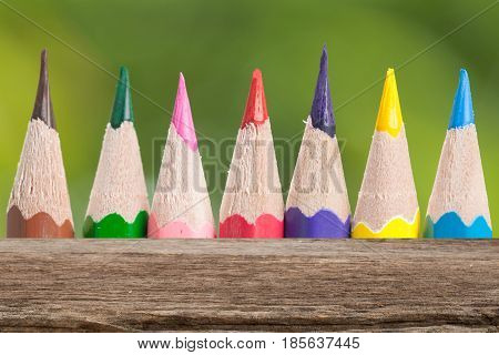Top of wood table on Color pencils background. Can be used for display or montage your products.