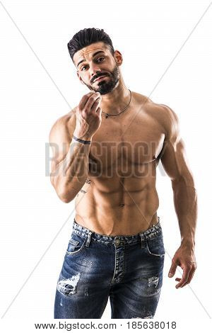 Handsome bodybuilder doing typical Italian hand gesture meaning a general question, with silly expression, looking at camera, isolated on white background