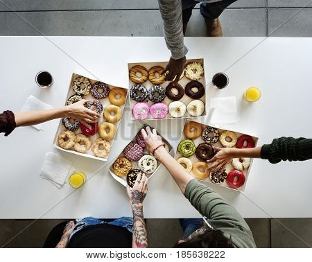 People Hands Reach Our Grabbing Doughnut