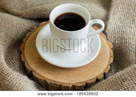Coffee on the stump. Composition with a cup of coffee in a rustic style.