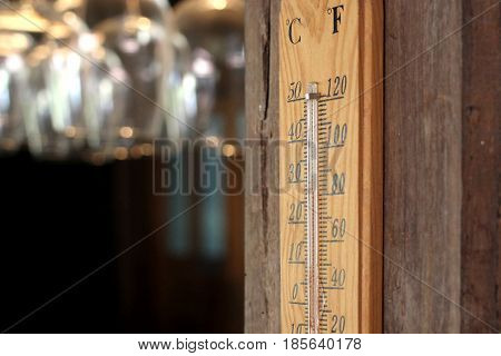 thermometer on wooden wall in the restaurant