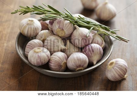 Bowl of whole chinese style garlic bulbs