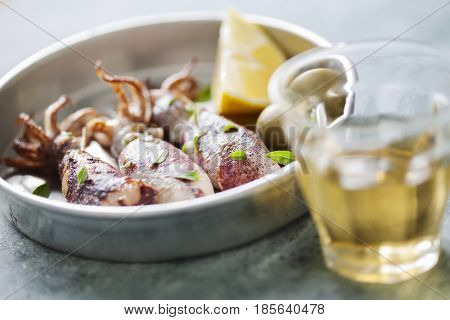 Fresh whole calamari cooked in oven