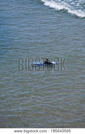 APRIL 23, 2017.  SANTA CRUZ, CA.  CIRCA:  Female surfer enjoying the waters in Santa Cruz, Ca.