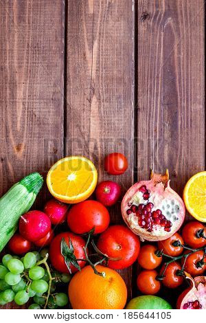 cooking salad with fresh fruits and vegetables on wooden desk background top view mock-up