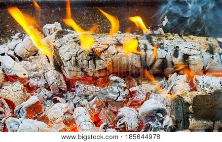 Charred Wood And Bright Flames Dark Background