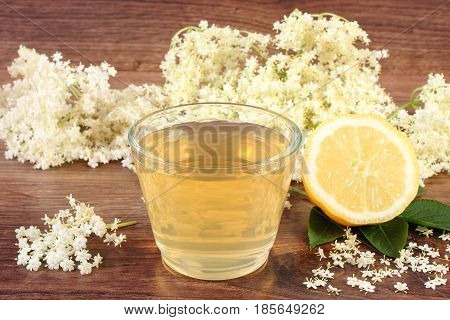 Healthy Juice, Elderberry Flowers And Lemon On Board, Alternative Therapy Concept