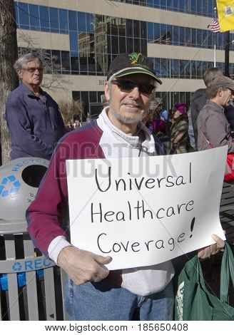 Asheville, North Carolina, USA - February 25, 2017: A man holds a sign saying
