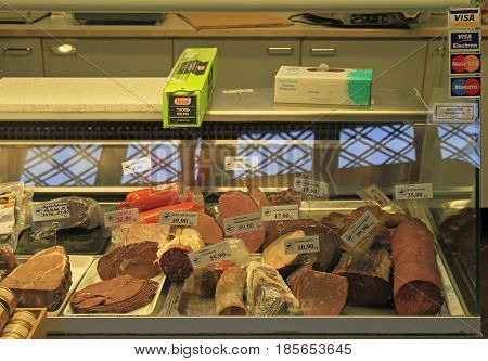 Oulu, Finland - April 11, 2017: Meat and sausages on shopwindow at the european market in Oulu, Finland