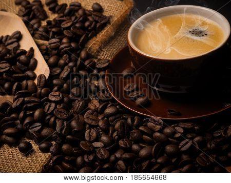 Cup of espresso with espresso beans close up shot