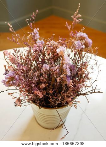 Dried flower in vase on the table.