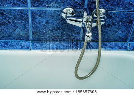 Close-up image of modern chrome tap and sink