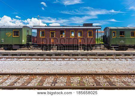 Nova Gorica (Gorizia) - June 2016, Italy: Vintage post-train cars on rails, old train at the station in Slovenian city of Nova Gorica. Sunny summer day